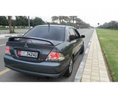 Mitsubishi lancer full option for Sale in Al-Ain