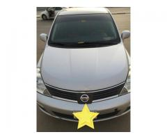 Nissan versa 2007 Hatchback for Sale in Abu Dhabi